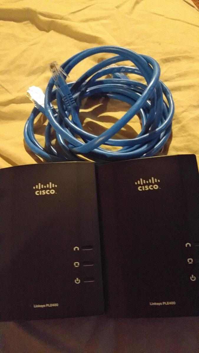 Photo of Cisco Powerline, Motorola Modem, DLINK routers, BELKIN wireless adapter
