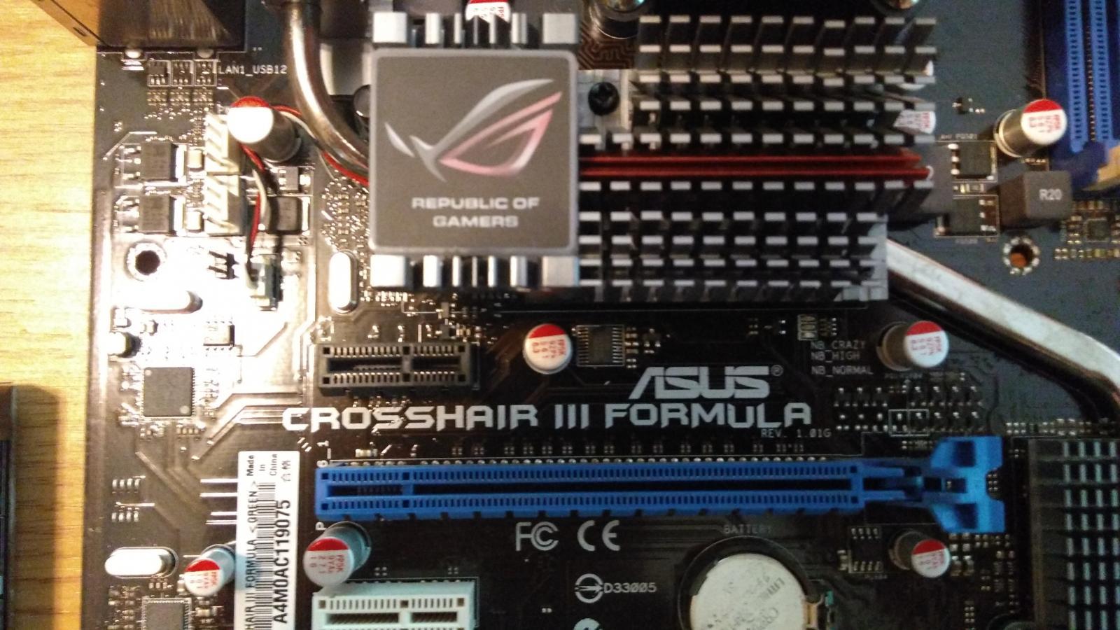 Photo of ASUS Crosshair III Formula AM3 AMD 790FX + AMD Phenom II 1055T + Heatsink COMBO