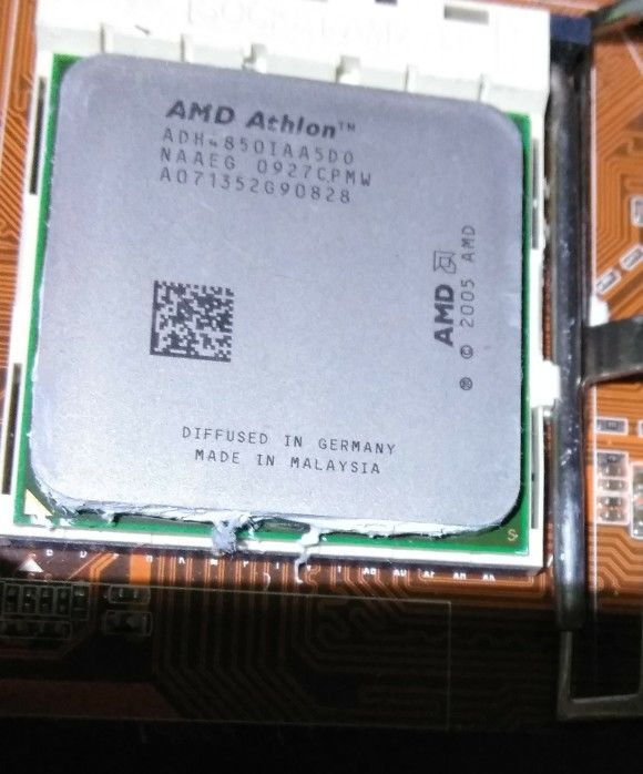 Photo of ecs kn1 Extreme abit ax78 3 cpu's HD3870 ATi video card and lots of ddr memory