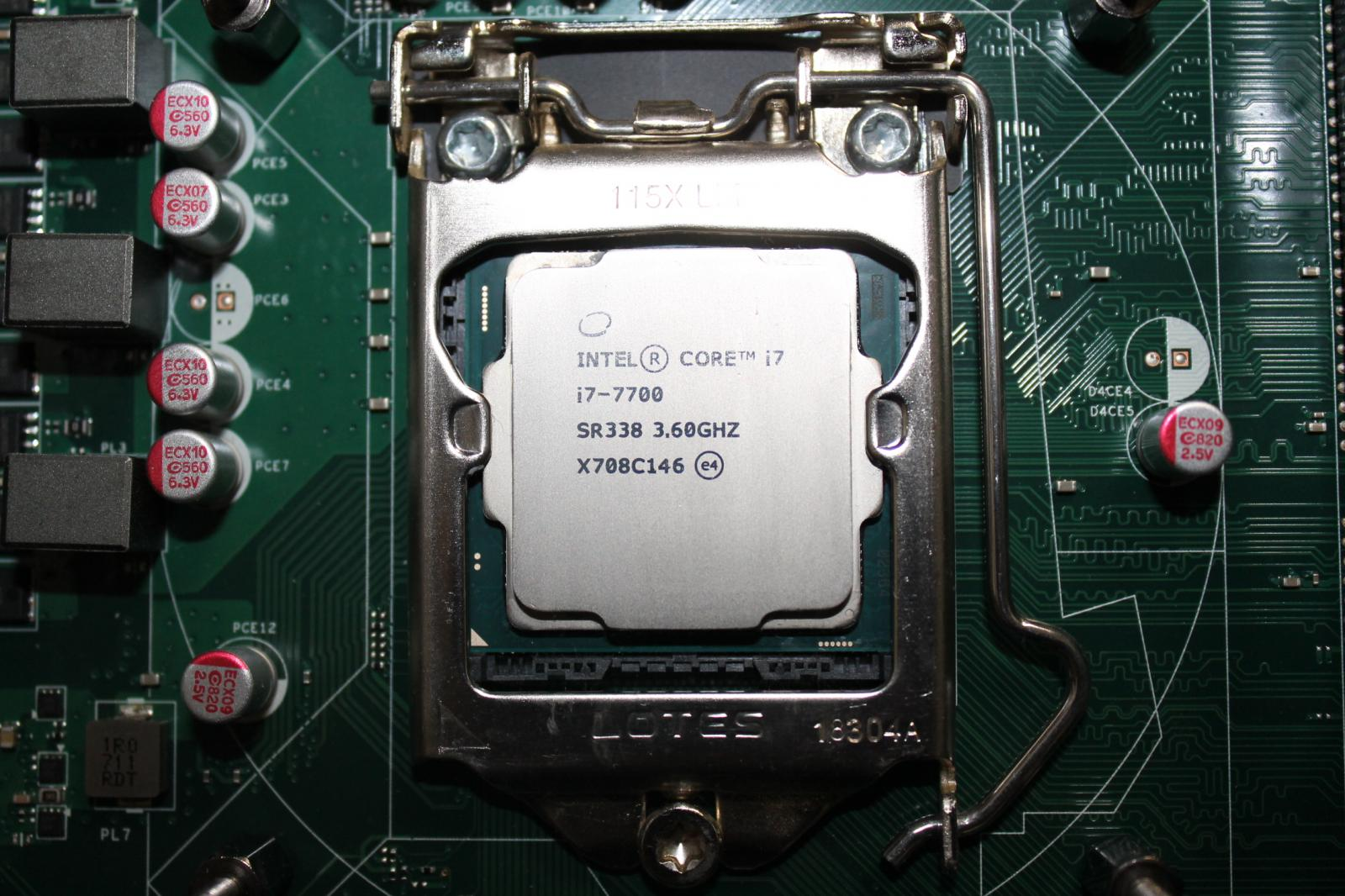 Photo of Intel i7-7700 with 8GB DDR4 2666Mhz ram stick and HP Omen motherboard.